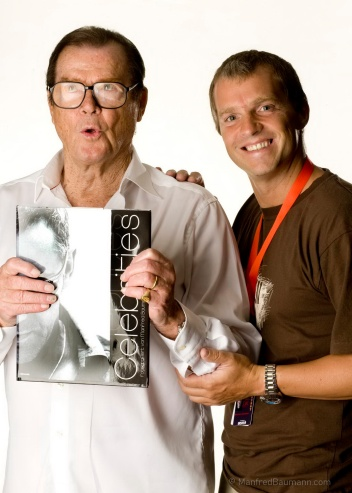 Manfred Baumann with the late actor Sir Roger Moore (photo courtesy of Manfred Baumann)