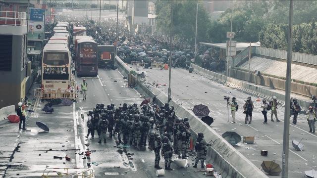 "Zhou Bing's crew filming a street demonstration in ""Hong Kong Moments"" (photo courtesy of Hot Docs Festival and Zhou Bing)"