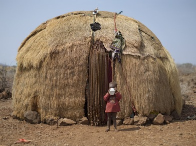 "A photo from Chris Jordan's 2011 series ""Ushirikiano"" depicting a Borana toddler in front of his home in Gotu Village, Kenya (photo courtesy of Chris Jordan)"